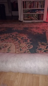 aubusson rug half unrolled because it is too big